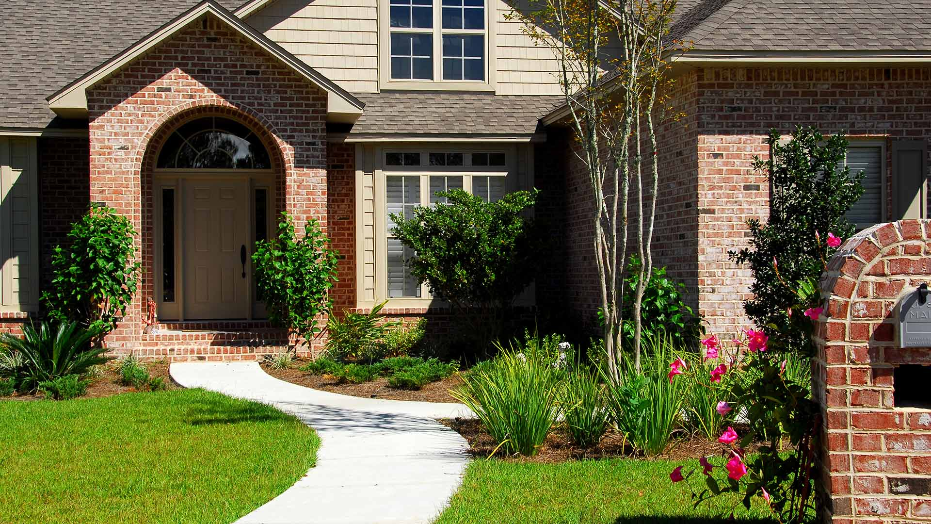 The path to the front door of this home represents the pathway towards good communication with clients.