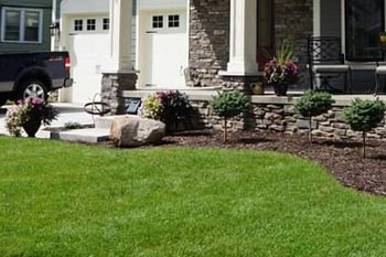 Troy home that receives ongoing fertilization and weed control by our professional technicians.