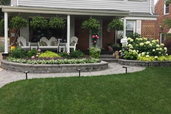 Landscaping in front of a residential home in Bloomfield that has recently been trimmed and pruned.